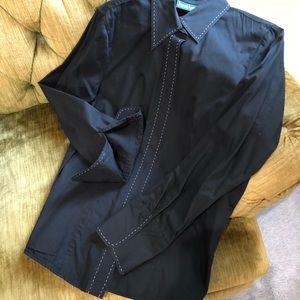 Black blouse with white stitching